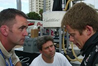 Chris Gorne and Eric Bernard listen to Emmanuele Collard's  debrief